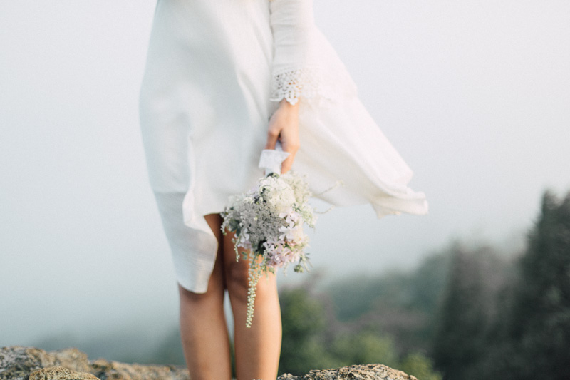 free spirit mountain bridal portraits session at sunrise with foraged wildflower bouquet