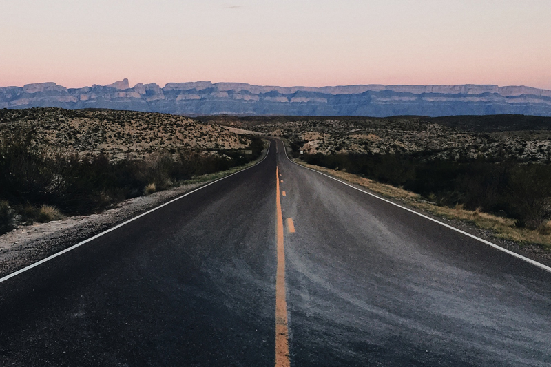 the main road going through big bend on the way to rio grand village campground at dusk - texas