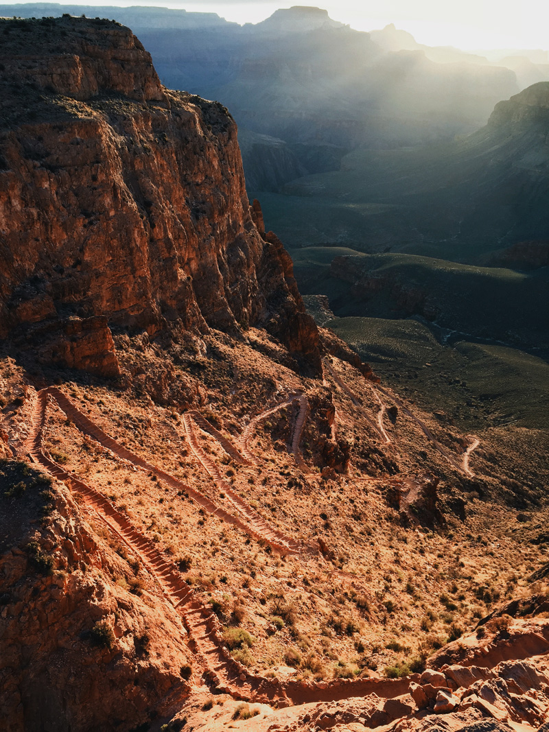 south kaibab trail below the grand canyon's south rim at sunrise rim to river to rim hike