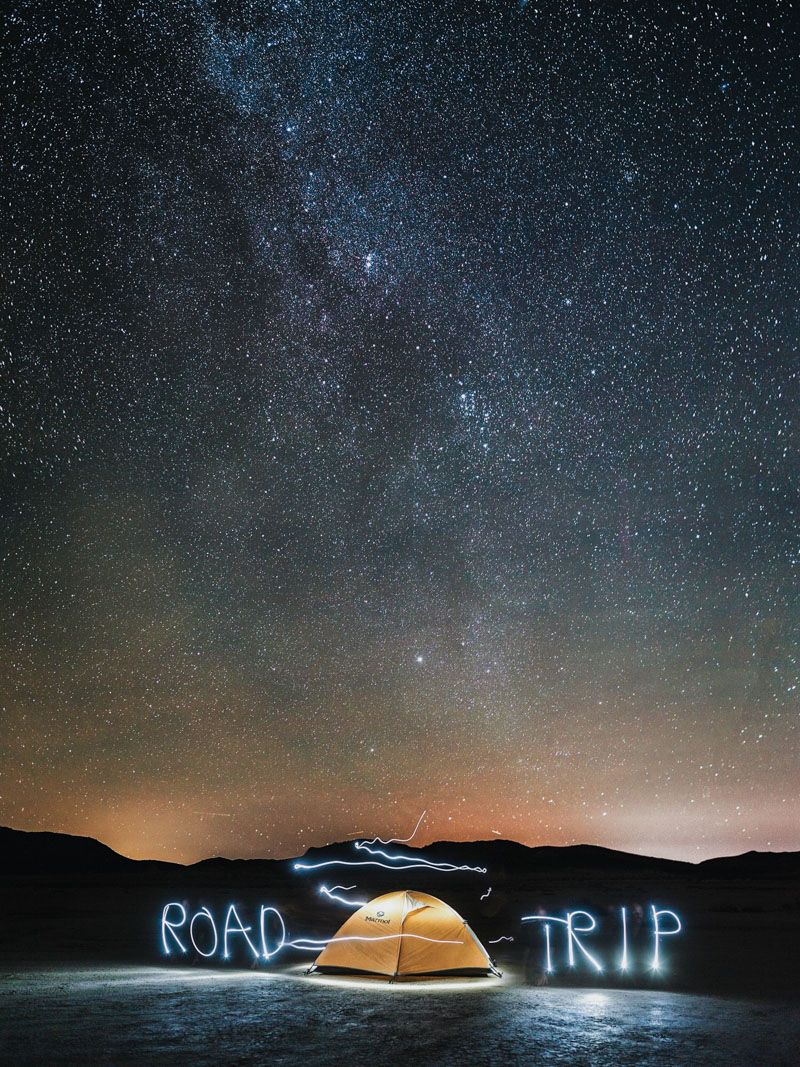 light painting our camp under the stars in the joshua tree BLM land near Joshua tree national park